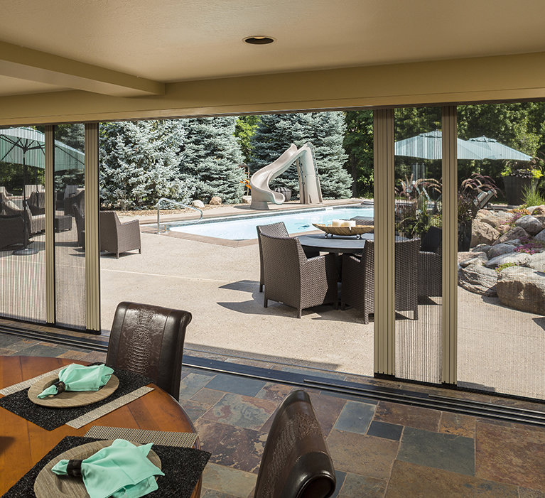 Larson storm doors retractable screen doors for Retractable outdoor screens
