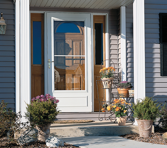 Pella storm doors rolscreen seasonal standard storm doors for Storm door with roll up screen